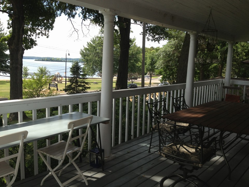 huge front porch overlooking lake enjoy front row seats from your own porch for lake minnetonka fireworks.